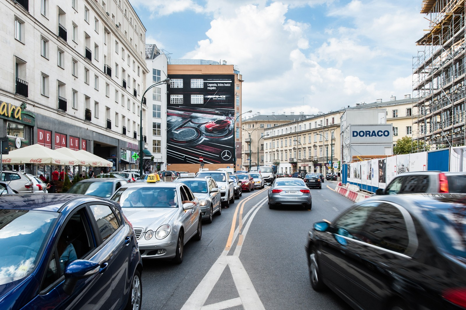A view from Krucza street on Dom Towarowy Bracia Jablkowscy and a Mercedes AMG advertising mural | Mercedes AMG | Portfolio