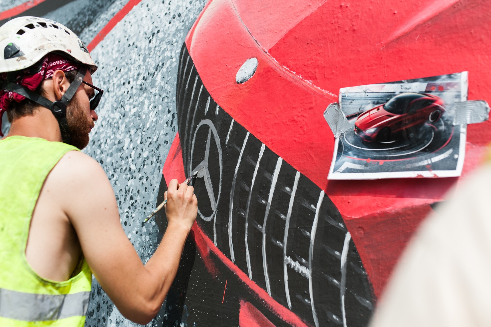 Artist painting a Mercedes AMG mural on Bracka street for Mercedes brand | Mercedes AMG | Portfolio