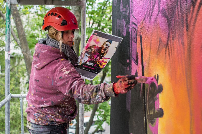 Artist's painting mural commisioned from Cenega brand in Warsaw | Rage 2 | Portfolio