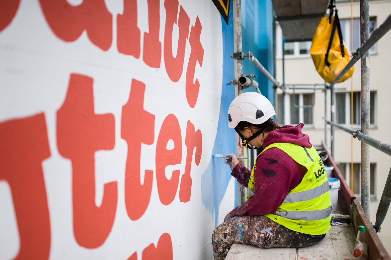 Artists painting a mural for Unilever next to Metro Politechnika station in Warsaw | Ben & Jerry's | Portfolio