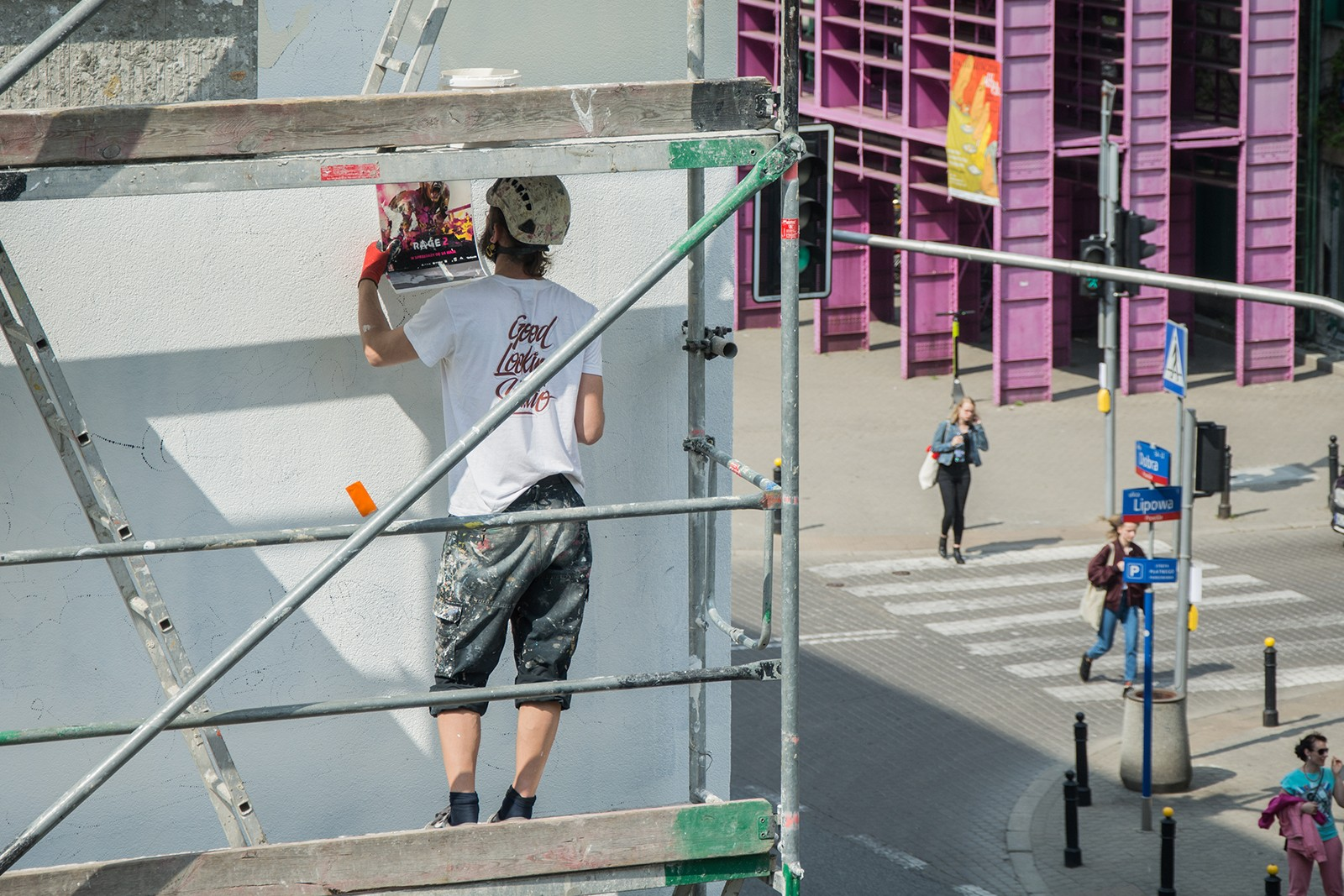 Artists paints advertisement mural Rage 2 near Dobra 53 street in Warsaw | Rage 2 | Portfolio