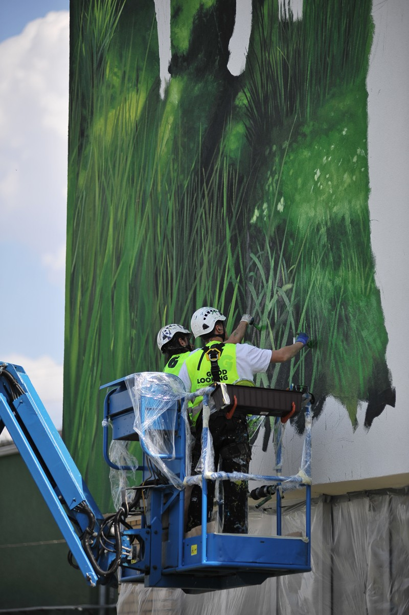 Artists painting a Polmos factory in Bialystok with a Zubrowka brand vodka theme | Zubrowka | Portfolio