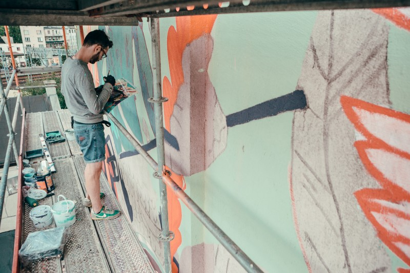 Artist painting a mural in Gdynia on Morska Street during an advertising campaign for Costa Coffee | Costa Coffee's 1st Birthday | Portfolio