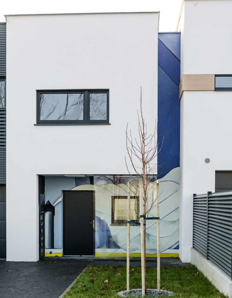 Residential building with an artistic painting in Futura Park housing estate | Osiedle Futura Park | Portfolio