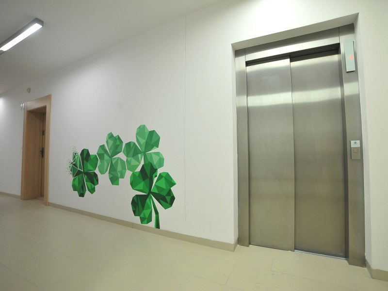 Clover on the wall inside building Residential Nowe Zamienie in Warsaw | Residential Nowe Zamienie | Portfolio