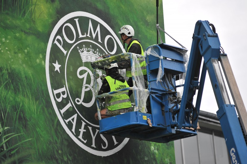 Polmos Bialystok Logo painted from a lift by artists on a wall of a factory manufacturing Zubrowka brand vodka | Zubrowka | Portfolio