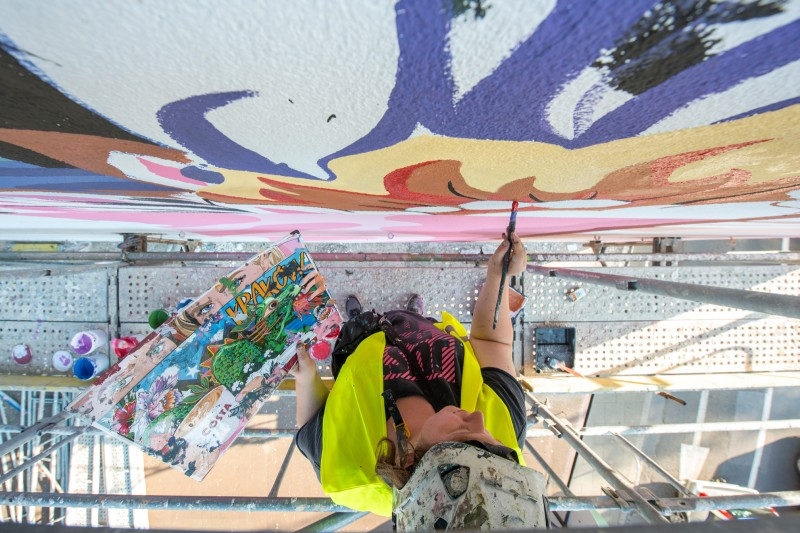 Painting a mural from a scaffolding on a building on Morska street in Gdynia  | Costa Coffee's 1st Birthday | Portfolio