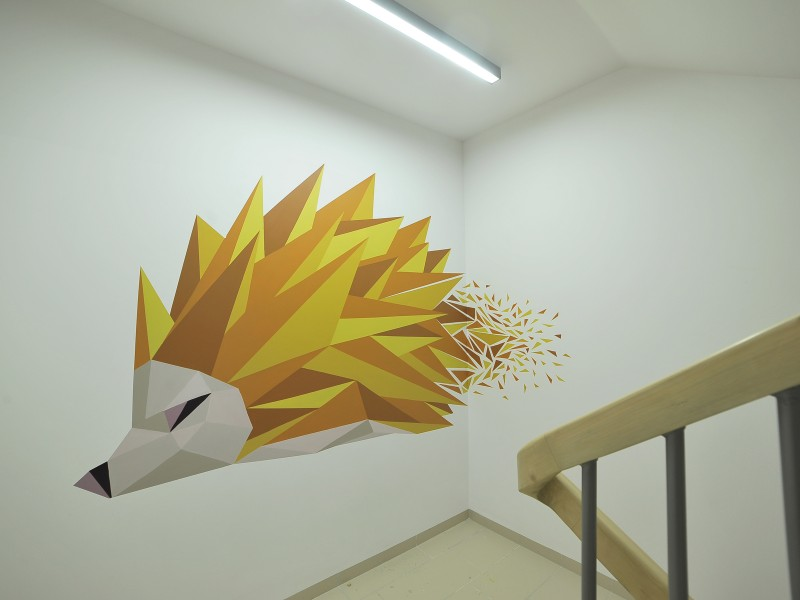 Creative mural on stairway wall in Warsaw Residential Nowe Zamienie | Residential Nowe Zamienie | Portfolio