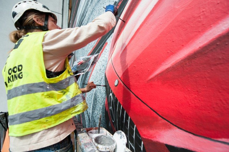 Mural being painted on a wall at the crossroads of Krucza and Bracka street for Mercedes-Benz Polska | Mercedes AMG | Portfolio