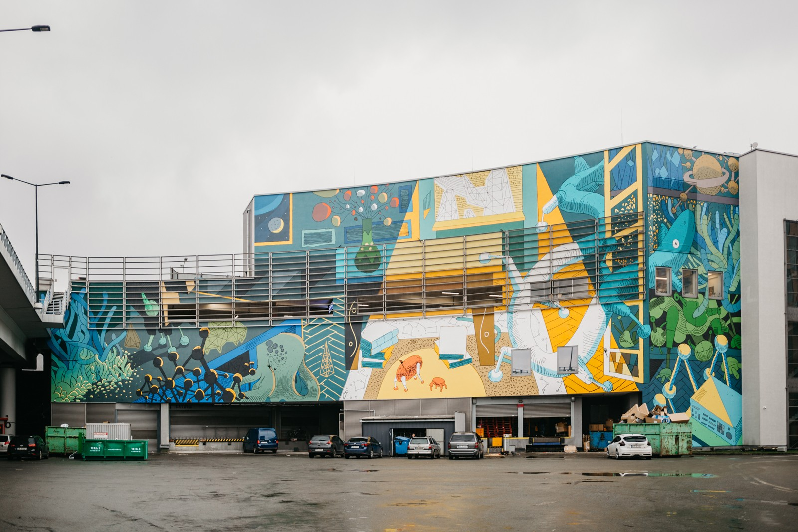 Mural above the loading ramp of Galeria Krakowska visible from the entrance to the parking  | Galeria Krakowska | Portfolio