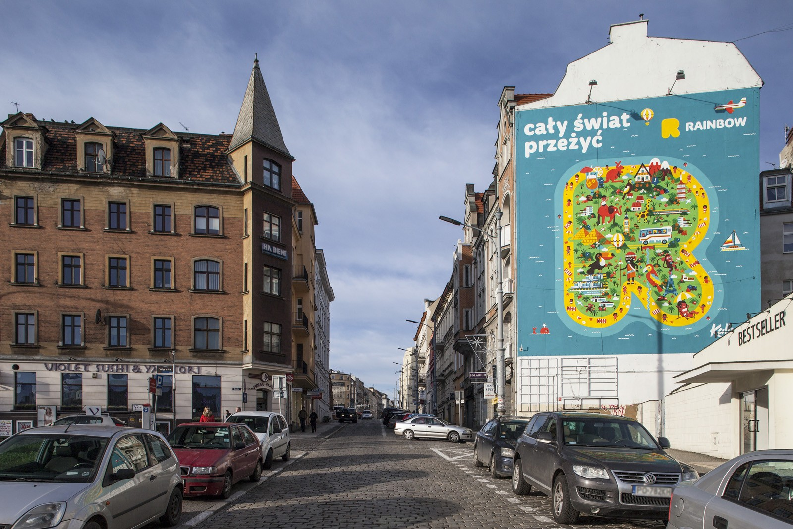 Mural reklamowy Rainbow w Poznaniu | The whole world experience | Portfolio