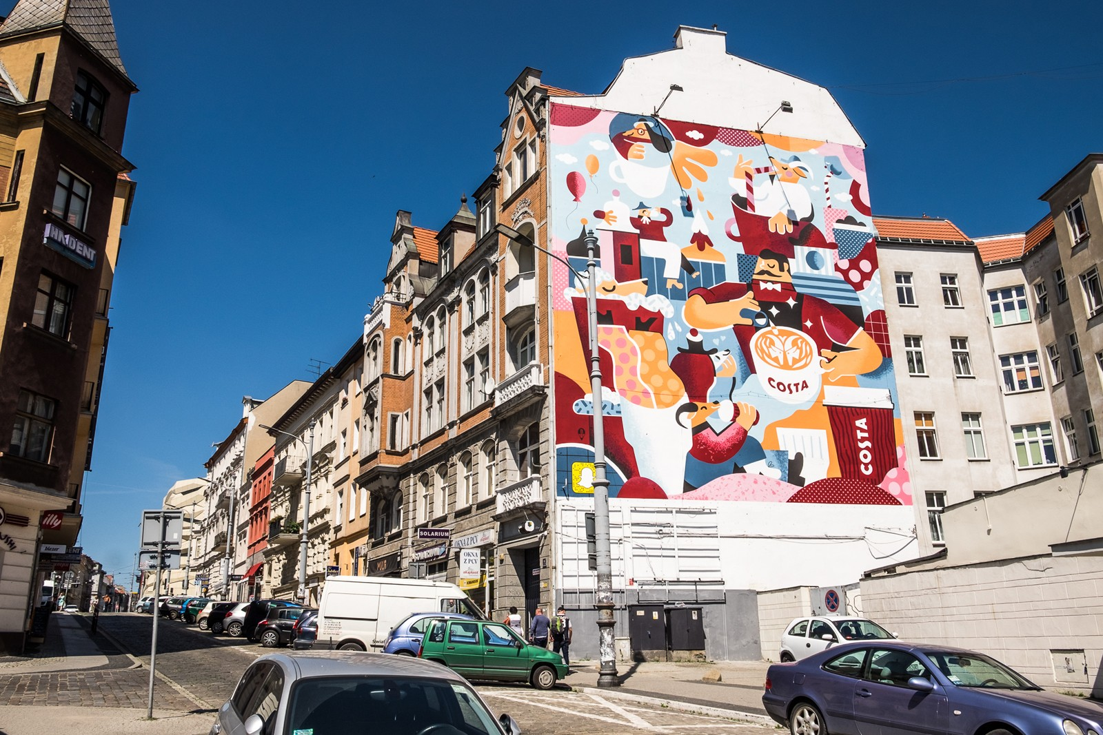 Mural in Poznan located on Swiety Marcin street for Costa Coffee brand project by Karol Banach | Costa Coffee's 1st Birthday | Portfolio