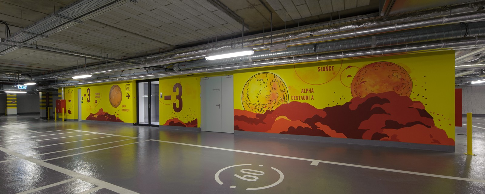 Painted sun and stars on garage walls in Warsaw's Proximo office building | PROXIMO | Portfolio