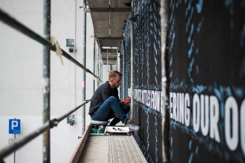 Painter painting mural for Adidas Warsaw | Adidas Parley | Portfolio