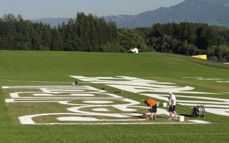 Painting of large Red Bull Air Race logotype at spielberg, Austria | branding miejsc na zlecenie RedBull | Portfolio