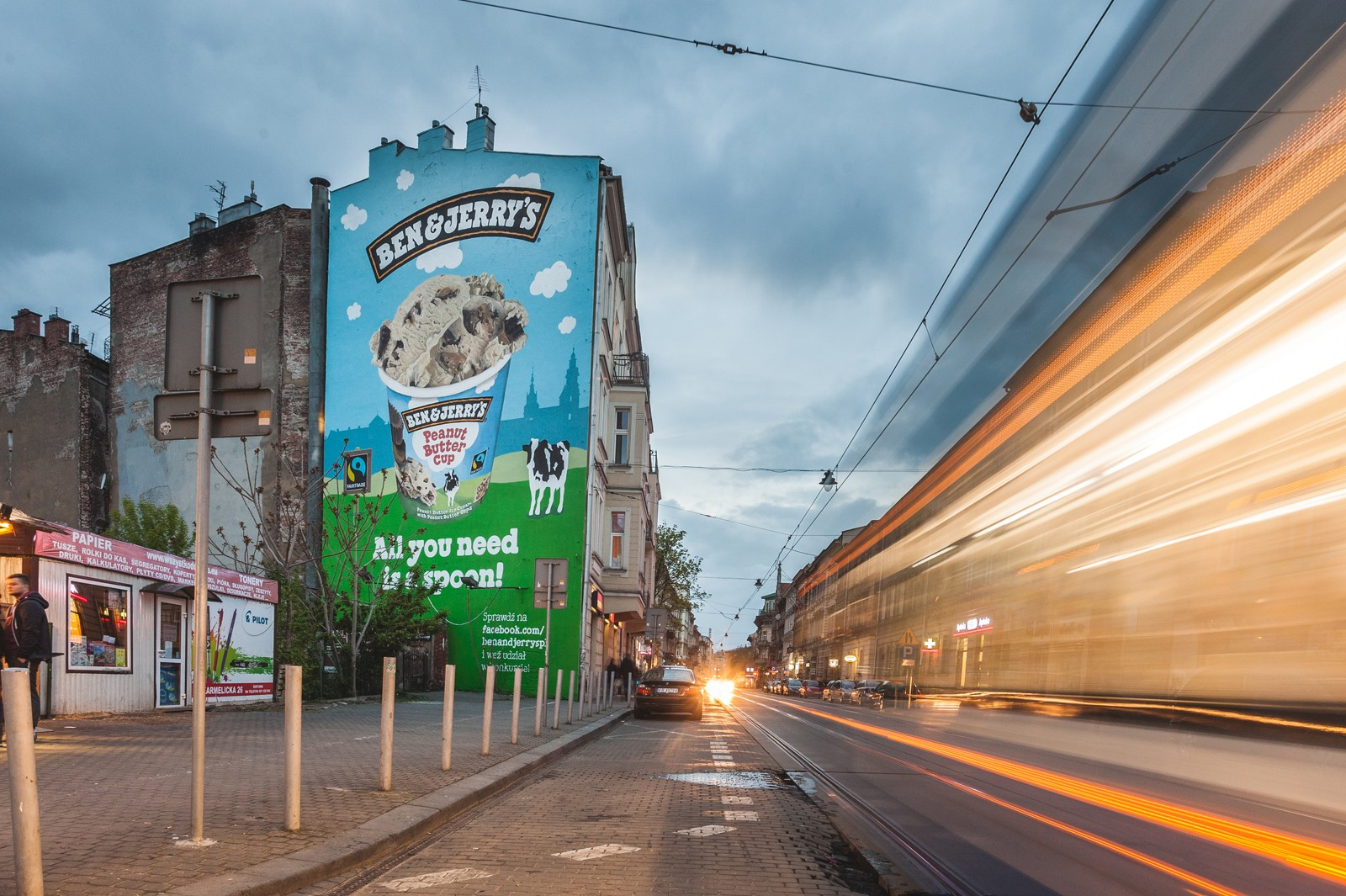 Karmelicka street in Cracow with a painted advertising mural for Unilever's Ben&Jerry's brand | Ben & Jerry's | Portfolio
