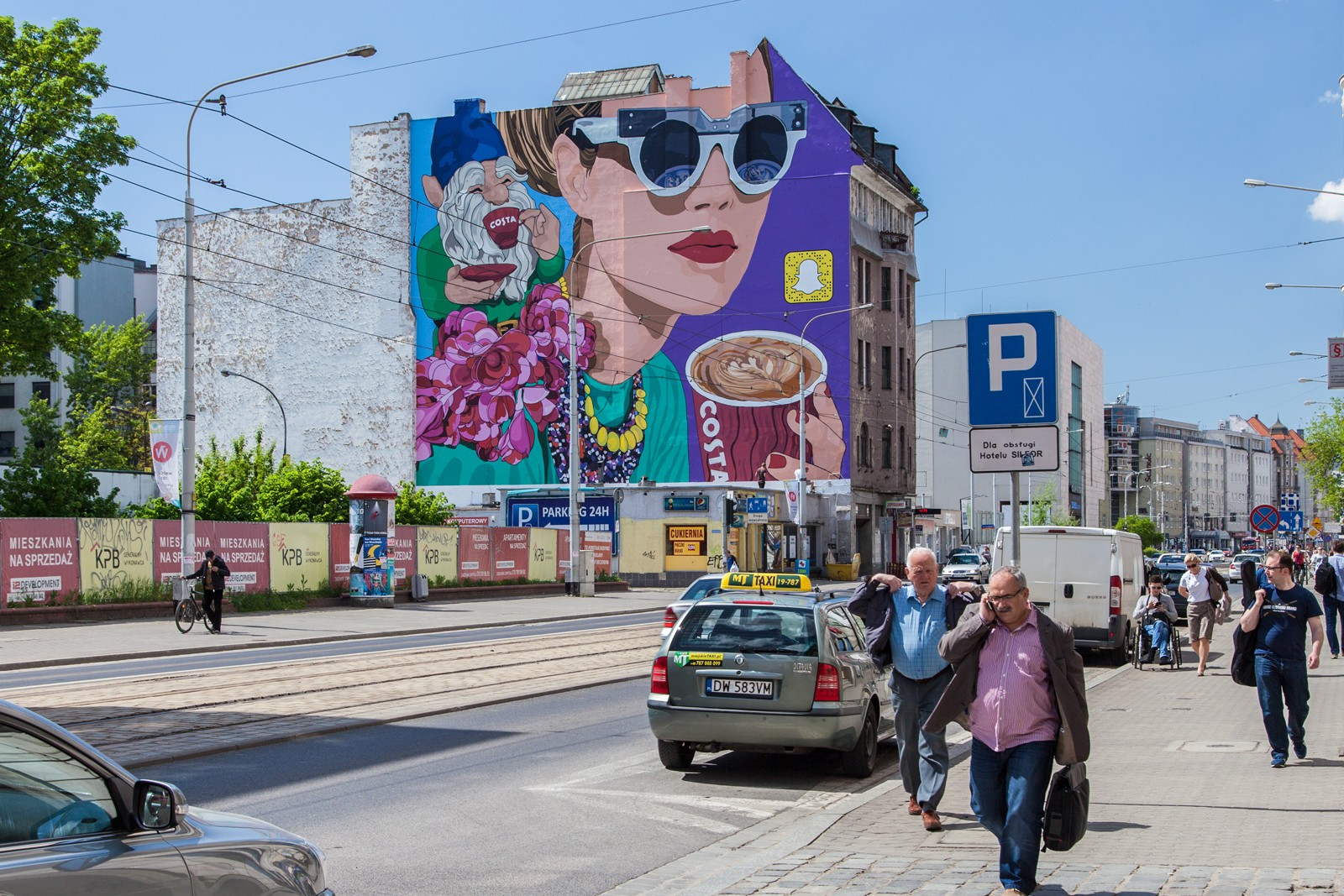 A mural in Wroclaw with a coffee drinking dwarf project by Olka Osadzinska located on Pilsudskiego 70 street | Costa Coffee's 1st Birthday | Portfolio