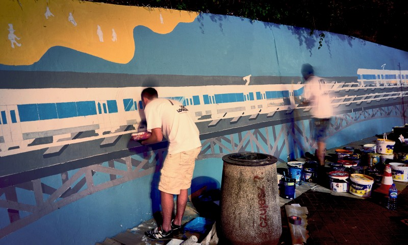 Painting mural on the wall near Centrum subway station for Samsung | Long live color! | Portfolio